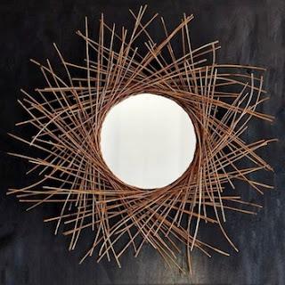 Espejo decorativo con ramas secas