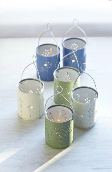Faroles decorativos para el jardín hechos con latas recicladas