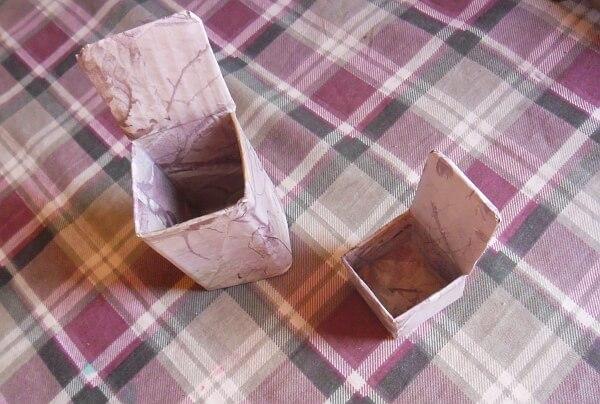 Cajas forradas con papel reciclado
